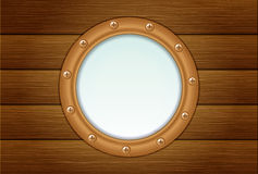 Porthole on wooden wall Royalty Free Stock Photography