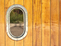 Porthole of a wooden yacht. A porthole of a wooden boat Stock Photos