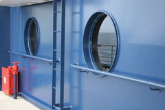 Portholes. In blue hull Stock Photos
