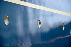 Portholes on a blue wall on a ship Royalty Free Stock Photo