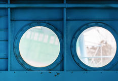 Portholes inside the aircraft Royalty Free Stock Photo