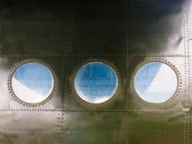 Portholes na starym samolocie Fotografia Royalty Free