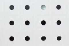 Portholes. Symmetrical rows of portholes of the ship Stock Images