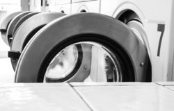 Washing machines in a laundry in black and white stock photos