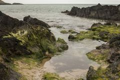 Porthor, The Whistling Sands - rocks. This image shows the Whistling Sands beach in North Wales, Porthor. It was taken on a cloudy day. It focuses on some rocks Royalty Free Stock Photos