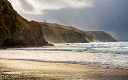 Porthtowan beach. Cornwall, United Kingdom, with the beach in the foreground, and headland beyond, with stormy clouds above Stock Images