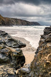 Porthtowan beach. Cornwall, United Kingdom, Looking through the rocks to the beach, and headland beyond Royalty Free Stock Photography