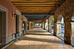 Portico in the central market square of a medieval town. In southern France stock photo