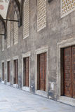 Portico with doors in a row in the courtyard of an ancient mosqu Stock Photo