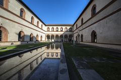 Ducal courtyards, Castello Sforzesco, Milan. The Portico of the Elephant, designed by the Tuscan architect, Benedetto Ferrini in 1473, and so called for the Royalty Free Stock Photo