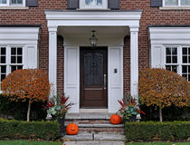 Portico entrance and pumpkins Royalty Free Stock Images