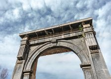 Portico of entrance to Roman citadel in ruins royalty free stock photo
