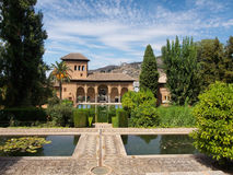 Portico, Garden Generalife in Alhambra, Granada, Spain. Alhambra patio with pool, day,sunny, clouds royalty free stock photo