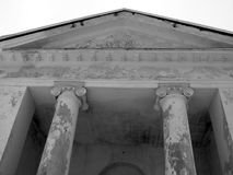 Porticus. Aged ionic columns; black and white image royalty free stock images