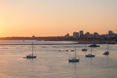 Portimao city view at sunset. Boats in the bay in a summer day. Royalty Free Stock Image