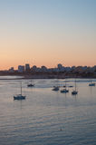 Portimao city view at sunset. Boats in the bay in a summer day. Royalty Free Stock Photo