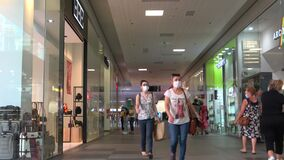 Portimao, Portugal - July 11, 2020: People shopping wearing protective face masks in Aqua Portimao shopping mall
