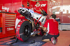 Superbikes 2011. PORTIMAO, Portugal - October 16: Athea team prepares the motorcycle of the Superbikes World Championship first place winner, Carlos Checa Stock Photo