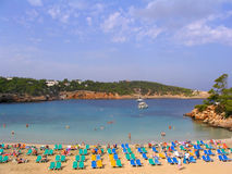 Portinatx beach (Ibiza, Spain). Colorful deck chairs on Portinatx beach (Ibiza, Spain Royalty Free Stock Photos
