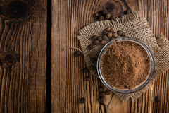 Portion of Allspice powder. (detailed close-up shot) on wooden background royalty free stock photos