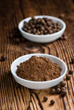 Portion of Allspice powder. (detailed close-up shot) on wooden background stock image