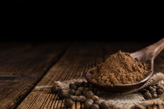 Portion of Allspice powder Royalty Free Stock Photography