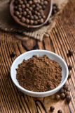 Portion of Allspice powder Royalty Free Stock Image