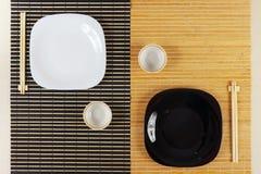 Portion av asiatisk kokkonst för två personer ovanför sikt Arkivbild