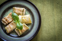Portion of baked zucchini rolls Royalty Free Stock Photo