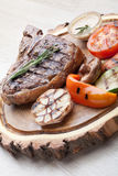 Portion of BBQ t-bone steak with  sauce  and grilled vegetables Stock Images