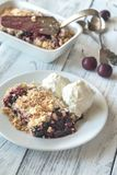 Portion of berry crumble with ice cream Stock Photography