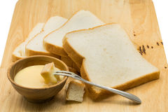 Portion of bread dip in sweetened condensed milk Stock Photos