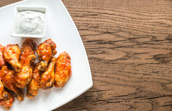 Portion of buffalo chicken wings. On the wooden table stock photography