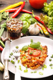 Portion of casserole with tomato and mushrooms Royalty Free Stock Image