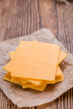 Portion of Cheddar Slices Stock Photography