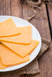 Portion of Cheddar Slices Royalty Free Stock Images