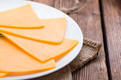 Portion of Cheddar Slices Royalty Free Stock Photos