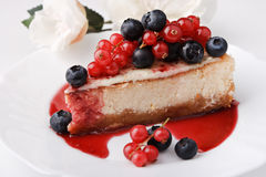Portion of cheese cake New-York with berries Royalty Free Stock Photo