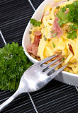 Portion of Cheese Spaetzle on black Stock Images