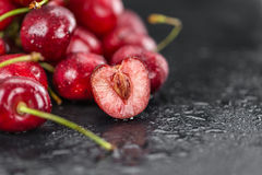 Portion of Cherries on a slate slab. Some Cherries on a slate slab as detailed close-up shot; selective focus Stock Photos