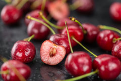 Portion of Cherries on a slate slab. Some Cherries on a slate slab as detailed close-up shot; selective focus Royalty Free Stock Images