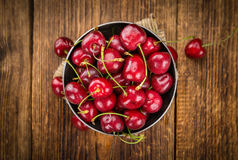 Portion of Cherries. Cherries on a vintage background as detailed close-up shot, selective focus Royalty Free Stock Image