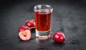 Portion of Cherry Liqueur on a slate slab Stock Photos
