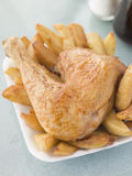 Portion Of Chicken And Chips On A Polystyrene Tray Royalty Free Stock Photography