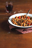 Portion of chickpea stew with cherry tomatoes Royalty Free Stock Photos