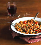 Portion of chickpea stew with cherry tomatoes Royalty Free Stock Image
