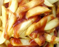 A portion of chips. With tomato ketchup Stock Photography