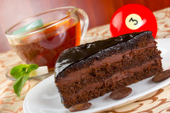 Portion of chocolate cake and cup of tea with fresh mint Royalty Free Stock Photos