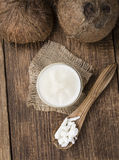 Portion of Coconut Oil. (selective focus) on a wooden table Royalty Free Stock Images