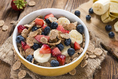 Portion of Cornflakes with fresh Fruits Royalty Free Stock Image
